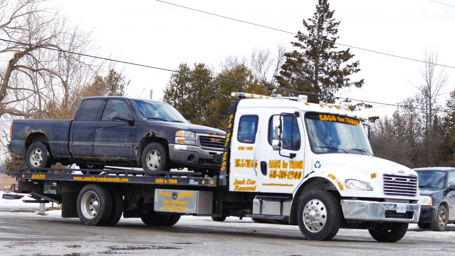 Scrap truck on flatbed tow truck removal Ottawa